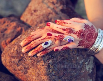 Mehendi mandalas in henna, the color of love